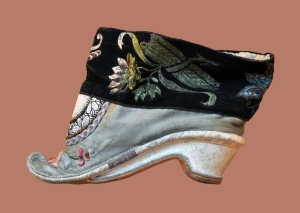 Chinese shoe for bound foot, 18th century. Musées du château des Rohan, Musée Louise Weiss, Saverne, France. The ideal length for a bound foot was 8 centimetres (3 in).Source: Wikipedia (CC0 1.0). Click to enlarge.
